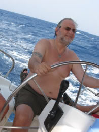 Mike at the helm of a Sun Odyssey 43 in the Southern Aegean, August '08